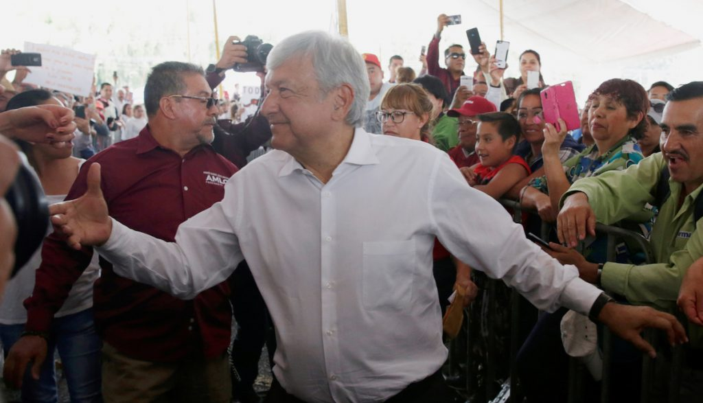 Leftist front-runner Andres Manuel Lopez Obrador of the National Regeneration Movement (MORENA) greets supporters during his campaign rally in Cuautitlan Izcalli, Mexico, April 13, 2018. REUTERS/Henry Romero