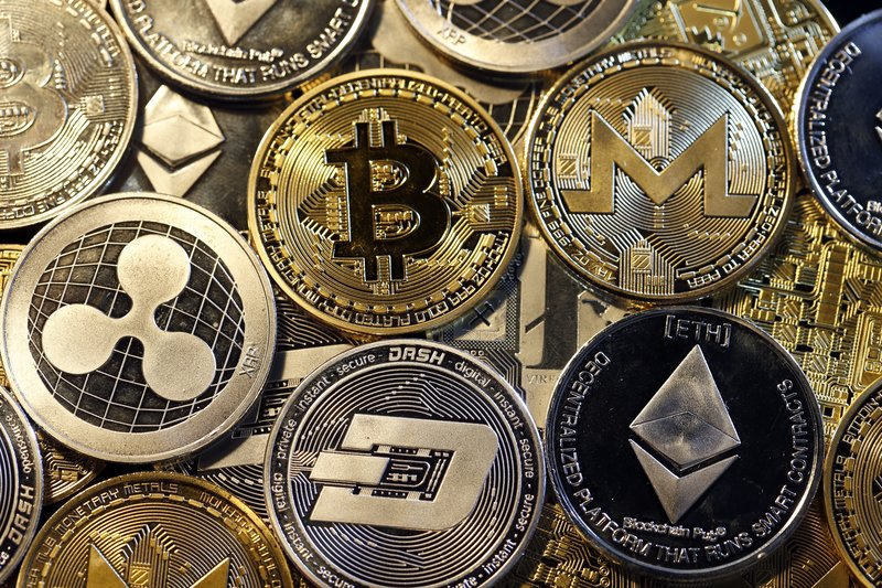 PARIS, FRANCE - FEBRUARY 16: In this photo illustration, a visual representation of digital cryptocurrencies, Bitcoin, Ripple, Ethernum, Dash, Monero and Litecoin is displayed on February 16, 2018 in Paris, France. Digital cryptocurrencies have seen unprecedented growth in 2017, despite remaining extremely volatile.  (Photo Illustration by Chesnot/Getty Images)
