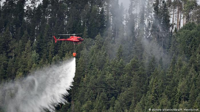 Firefighters tried to put out this blaze in Sweden on July 22 using a helicopter