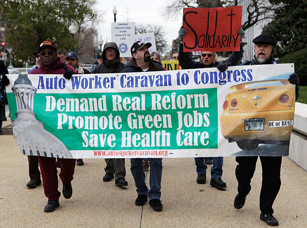 WASHINGTON - DECEMBER 08:  Auto workers and retirees, who are part of a caravan from several Midwest states to Congress, march on Capitol Hill December 8, 2008 in Washington, DC. Auto workers went to Washington to urge lawmakers to save the auto industry.  (Photo by Alex Wong/Getty Images)