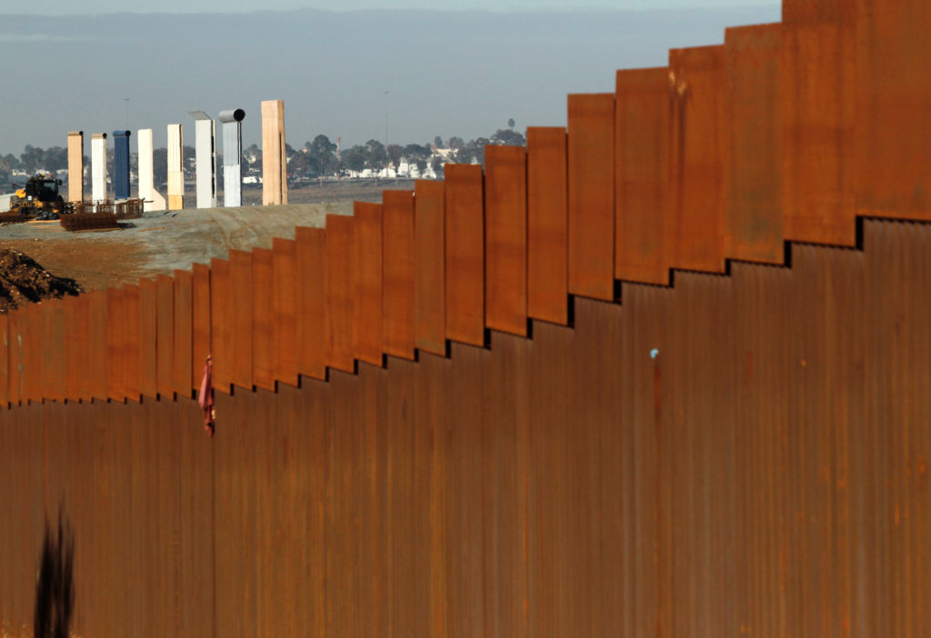 The prototypes for U.S. President Donald Trump's border wall are seen behind the border fence between Mexico and the United States, in Tijuana, Mexico January 7, 2019. REUTERS/Jorge Duenes - RC1B258D6BC0