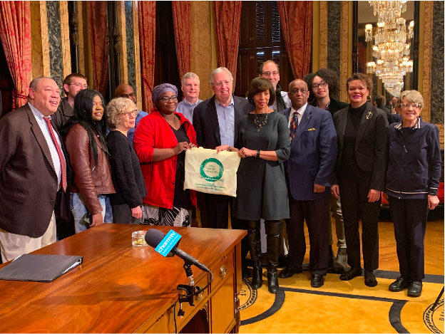 Mayor Pugh stands with members of Baltimore City Council and environmental advocates at the signing ceremony