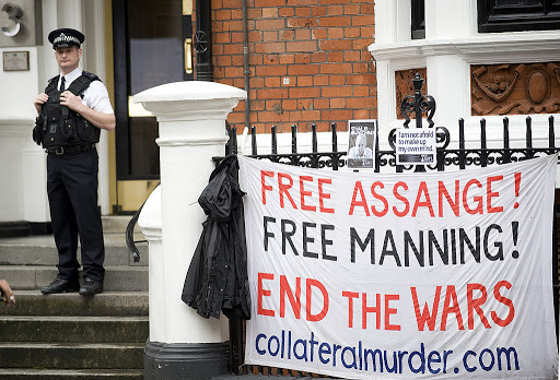 Free Assange Free Manning Sign with Cop