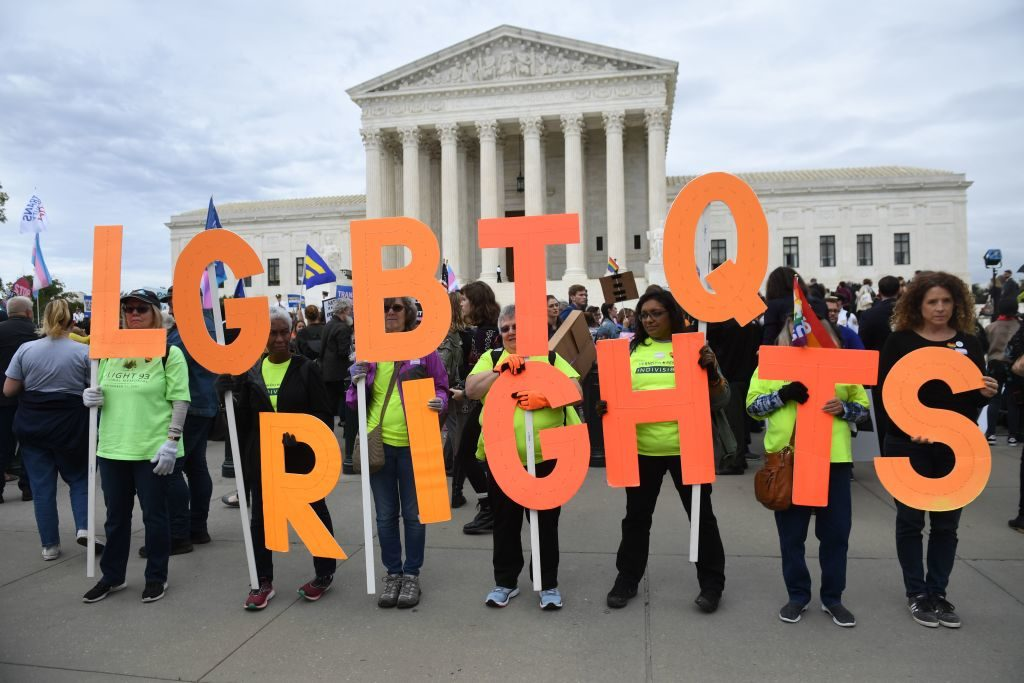 Demonstrators in favour of LGBT rights rally outside the US Supreme Court in Washington, DC, October 8, 2019, as the Court holds oral arguments in three cases dealing with workplace discrimination based on sexual orientation. (Photo by SAUL LOEB / AFP) (Photo by SAUL LOEB/AFP via Getty Images)