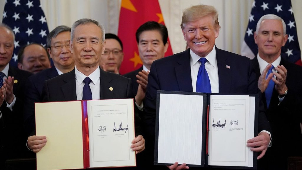 """U.S. President Donald Trump stands Chinese Vice Premier Liu He after signing """"phase one"""" of the U.S.-China trade agreement in the East Room of the White House in Washington, U.S., January 15, 2020. REUTERS/Kevin Lamarque? - RC2IGE9ACM3F"""