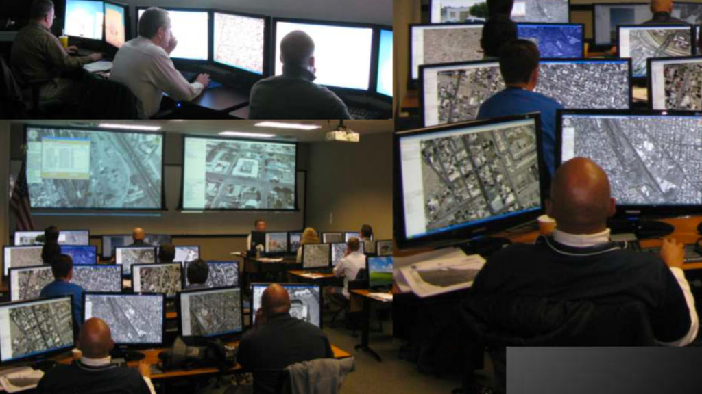 Surveillance plane analysts at work. Image courtesy of Persistent Surveillance Systems.