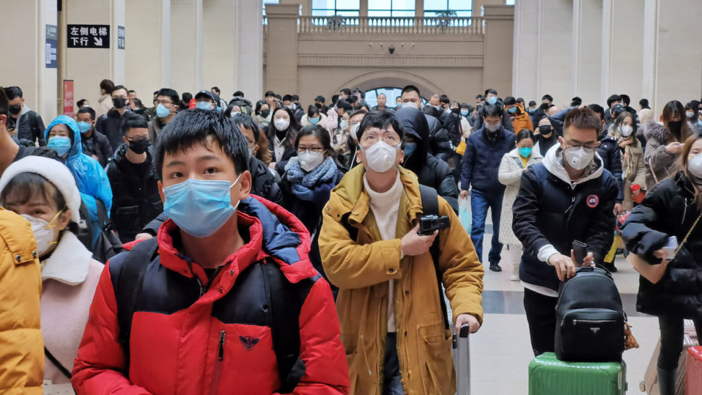 """WUHAN, CHINA - JANUARY 22: People wear face masks as they wait at Hankou Railway Station on January 22, 2020 in Wuhan, China. A new infectious coronavirus known as """"2019-nCoV"""" was discovered in Wuhan last week. Health officials stepped up efforts to contain the spread of the pneumonia-like disease which medical experts confirmed can be passed from human to human. Cases have been reported in other countries including the United States,Thailand, Japan, Taiwan, and South Korea. It is reported that Wuhan will suspend all public transportation at 10 AM on January 23, 2020.   (Photo by Getty Images)"""