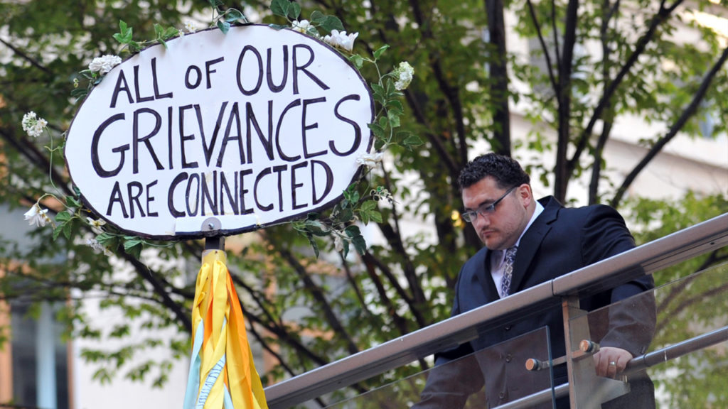 A man looks down at a sign during the Occupy Wall Street protest September 17, 2012 on the one year anniversary of the movement in New York. Stan Honda/AFP/Getty Images