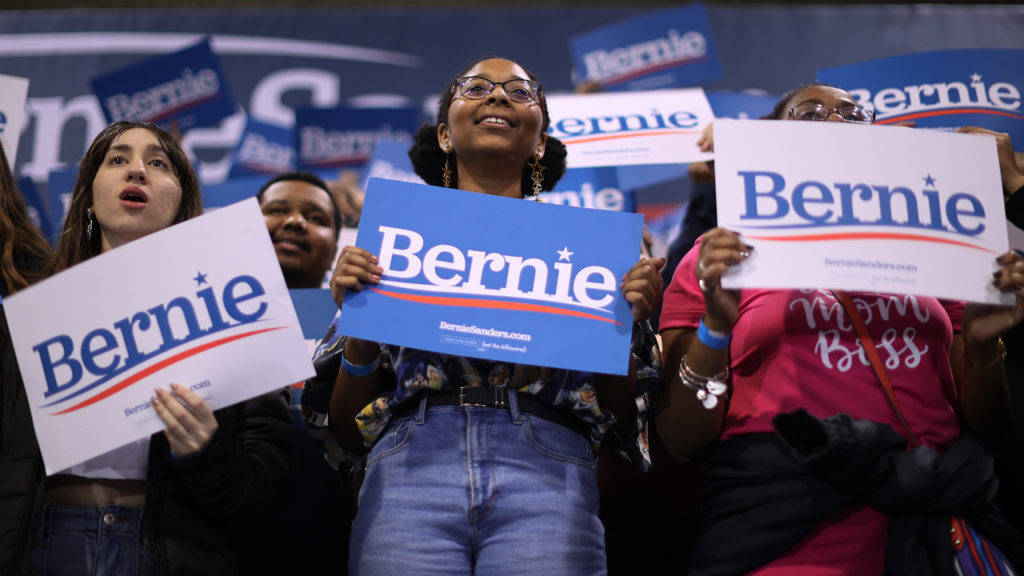 Supporters listen to Democratic presidential candidate Sen. Bernie Sanders (I-VT) during a campaign rally in the Batten Student Center on the campus of Virginia Wesleyan University February 29, 2020 in Virginia Beach, Virginia. Chip Somodevilla/Getty Images