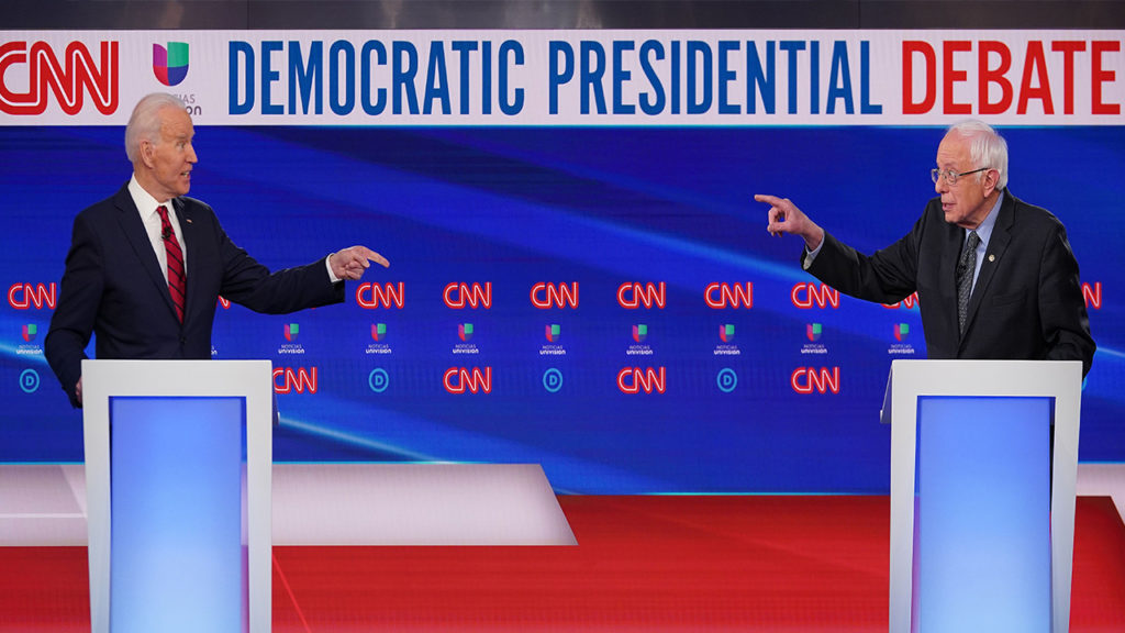 US vice president Joe Biden (L) and Senator Bernie Sanders point fingers at each other as they take part in the 11th Democratic Party 2020 presidential debate in a CNN Washington Bureau studio in Washington, DC on March 15, 2020. (Photo by Mandel NGAN / AFP) (Photo by MANDEL NGAN/AFP via Getty Images)