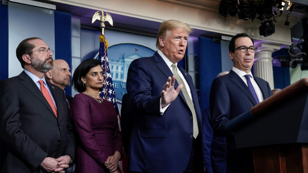 U.S. President Donald Trump (C) and Treasury Secretary Steven Mnuchin (R), joined by members of the Coronavirus Task Force, field questions about the coronavirus outbreak in the press briefing room at the White House on March 17, 2020 in Washington, DC. The Trump administration is considering an $850 billion stimulus package to counter the economic fallout as the coronavirus spreads. Drew Angerer/Getty Images