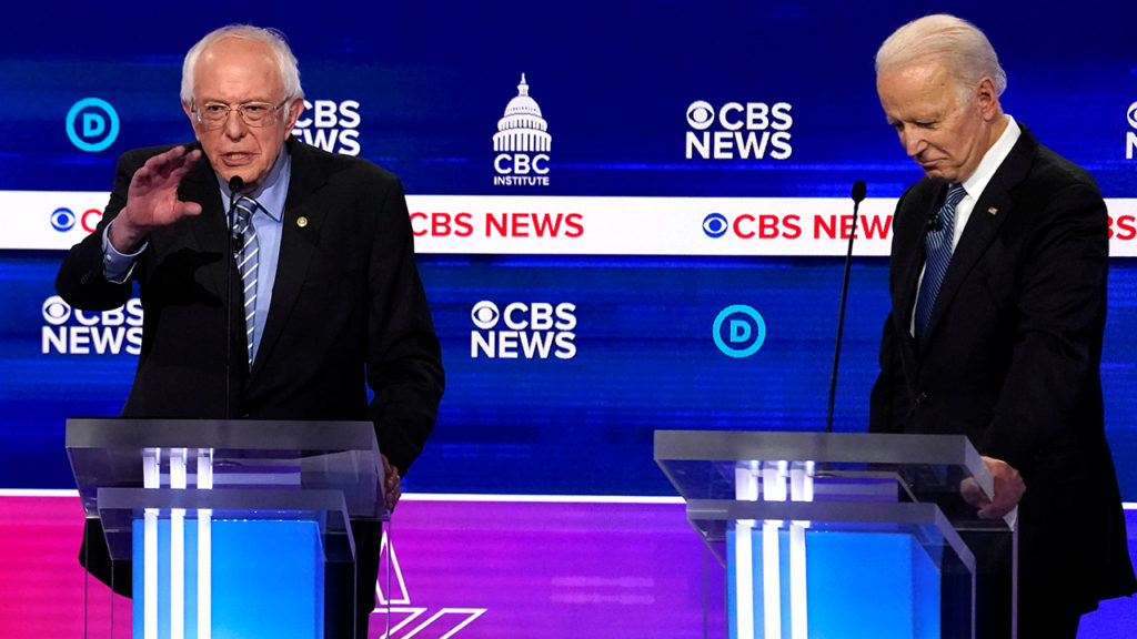 Democratic 2020 U.S. presidential candidates Senator Bernie Sanders spars with Vice President Joe Biden listens at the tenth Democratic 2020 presidential debate at the Gaillard Center in Charleston   Byline: Jonathan Ernst Source: REUTERS