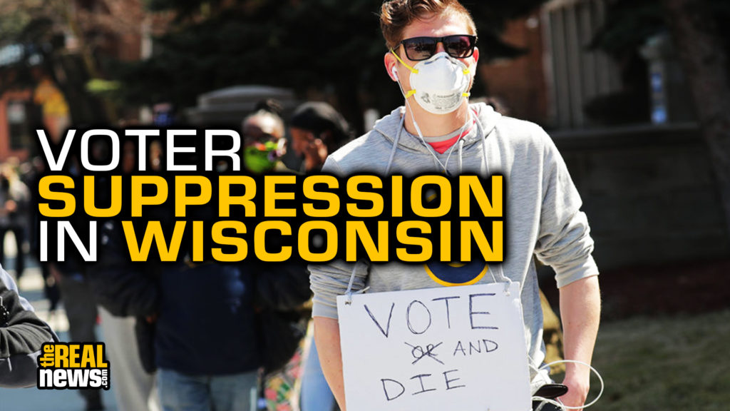 Apr 7, 2020; Milwaukee, Wisconsin, USA; Torin Fendos, of Milwaukee, wears a sign voicing his view while waiting to vote at Riverside High School, 1615 E. Locust St. in Milwaukee on Tuesday, April 7, 2020. The Wisconsin primary is moving forward in the wake of the coronavirus epidemic after Gov. Tony Evers sought to shut down Tuesday's election in a historic move Monday that was swiftly rejected by the conservative majority of the Wisconsin Supreme Court by the end of the day. Mandatory Credit: Mike De Sisti/Milwaukee Journal Sentinel via USA TODAY NETWORK