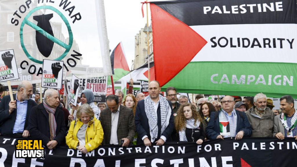 LONDON, GREATER LONDON, UNITED KINGDOM - 2019/05/11: Lindsey German from Stop the War Coalition (L) Palestinian ambassador in UK Husam Zomlot (centre), Palestinian humans rights activist Ahed Tamimi (right) are seen marching during the protest. Andres Pantoja/SOPA Images/LightRocket via Getty Images