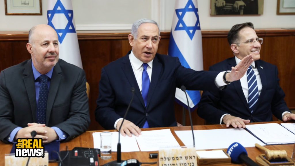 Israeli Prime Minister Benjamin Netanyahu (C), Cabinet Secretary Tzahi Braverman (R) and Israeli Minister of Regional Cooperation Tzachi Hanegbi (L) attend the weekly cabinet meeting at the Prime Minister's office in Jerusalem, on December 29, 2019. Abir Sultan/POOL/AFP via Getty Images