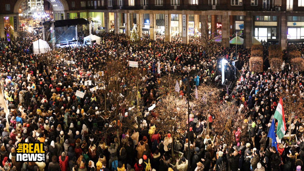 In this panorama picture taken in Budapest, Hungary on December 9, 2019 demonstrators protest during a demonstration against the cultural policy of Hungarian Prime Minister Viktor Orban's government. Attila Kisbenedek/AFP via Getty Images