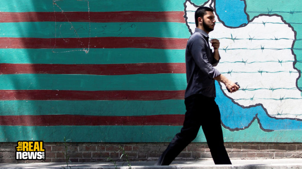 A man walks past the mural showing U.S. flag with barbed wire in Tehran, Iran June 25, 2019. Nazanin Tabatabaee/West Asia News Agency via REUTERS