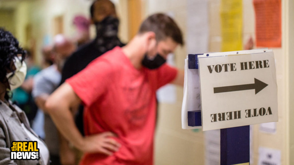 Voters wait in long lines, at times in the rain, at New Beginnings Full Gospel Church on Tuesday, June 9, 2020. The lines were taking more than three and a half hours. This polling location opened at 7 a.m. with only one machine of the four available working and had two of the four working at 4:30 p.m. and were not providing provisional ballots.