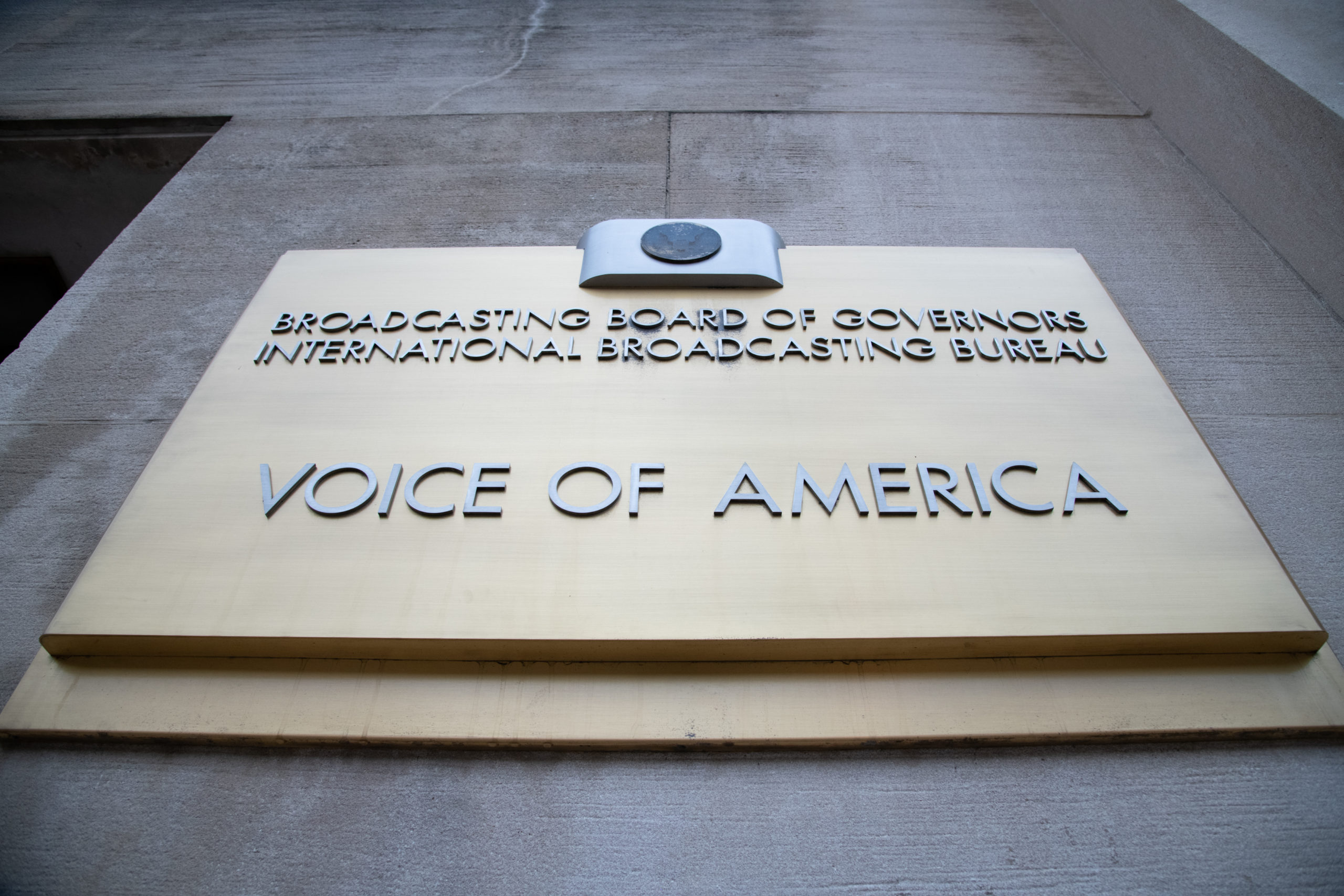 A general view of the Voice of America (VOA) sign on its headquarters in Washington, D.C., on July 31, 2020 amid the Coronavirus pandemic. This week the United States surpassed 150,000 confirmed deaths from COVID-19, although the actual count is thought to be significantly higher, as negotiations within the Republican Party and Senate sputtered ahead of crucial deadlines for unemployment insurance, eviction and the greater stimulus package. (Graeme Sloan/Sipa USA)No Use UK. No Use Germany.