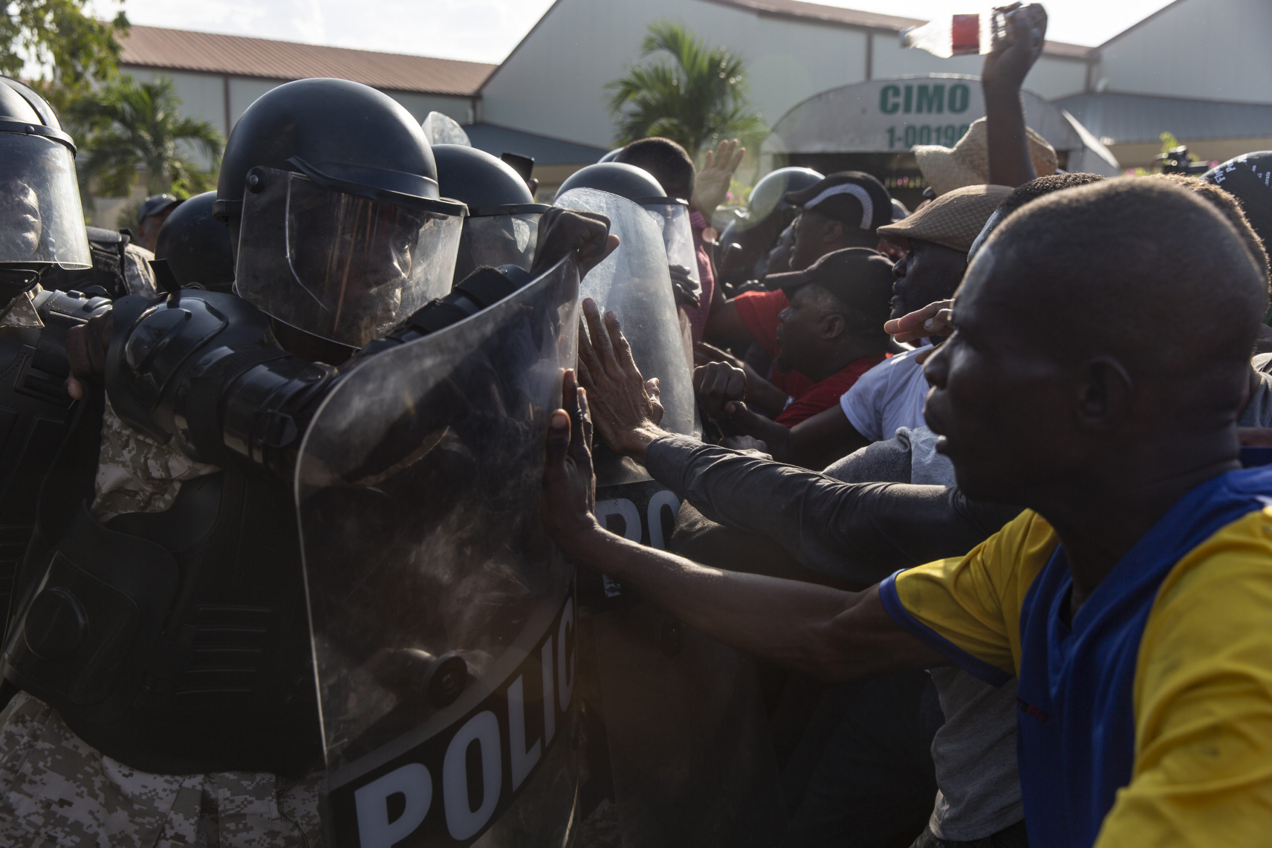 PORT AU PRINCE, HAITI - 2019/12/07: Demonstrators clash with police outside the US Embassy. For over a year tensions has been high in Haiti, widespread governmental corruption and the misuse of Venezuelan loans through the Petro Caribe program has led many people to take to the streets demanding that President Jovenel Moïse steps down. Country wide protests and the threat of violence has brought the nation to a near standstill with many businesses and schools have now been shuttered for months. With both sides digging in there seems no end in sight. (Photo by Adam DelGiudice/SOPA Images/LightRocket via Getty Images)