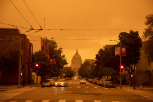 Smoke from climate change-fueled wildfires blocks out California sun